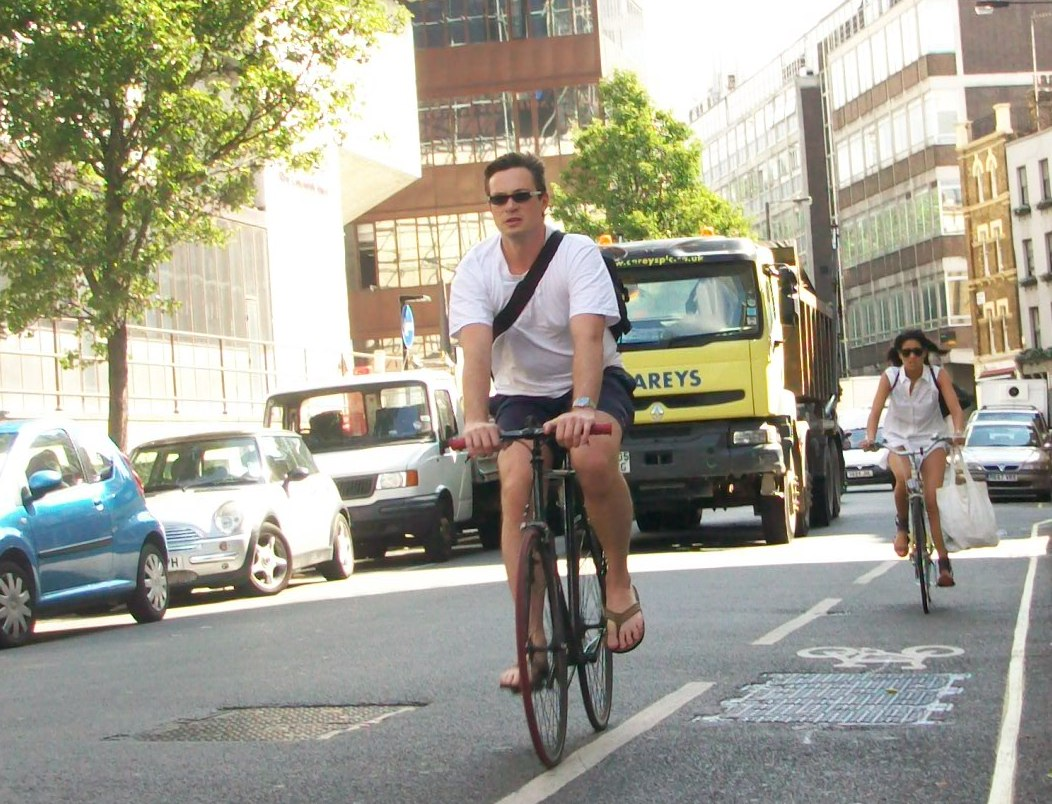 Man and woman cycling along New Cavendish Street