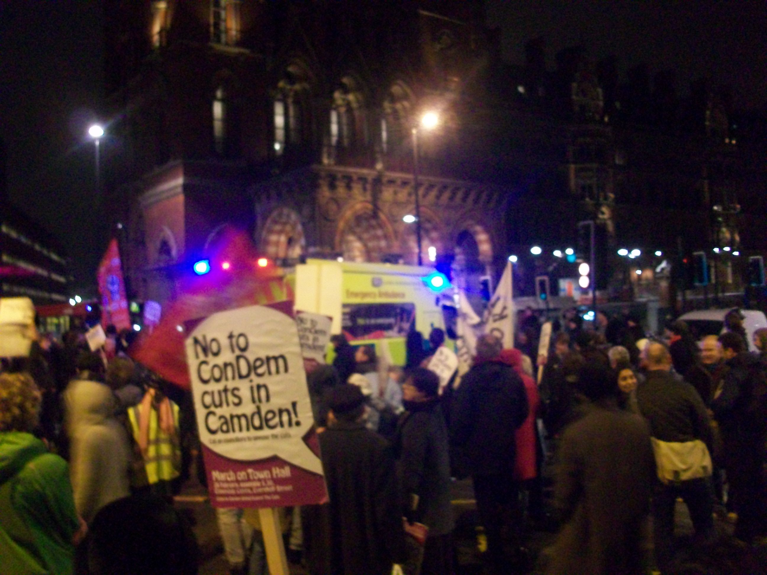 """""""No to ConDem cuts in Camden"""" reads a placards"""