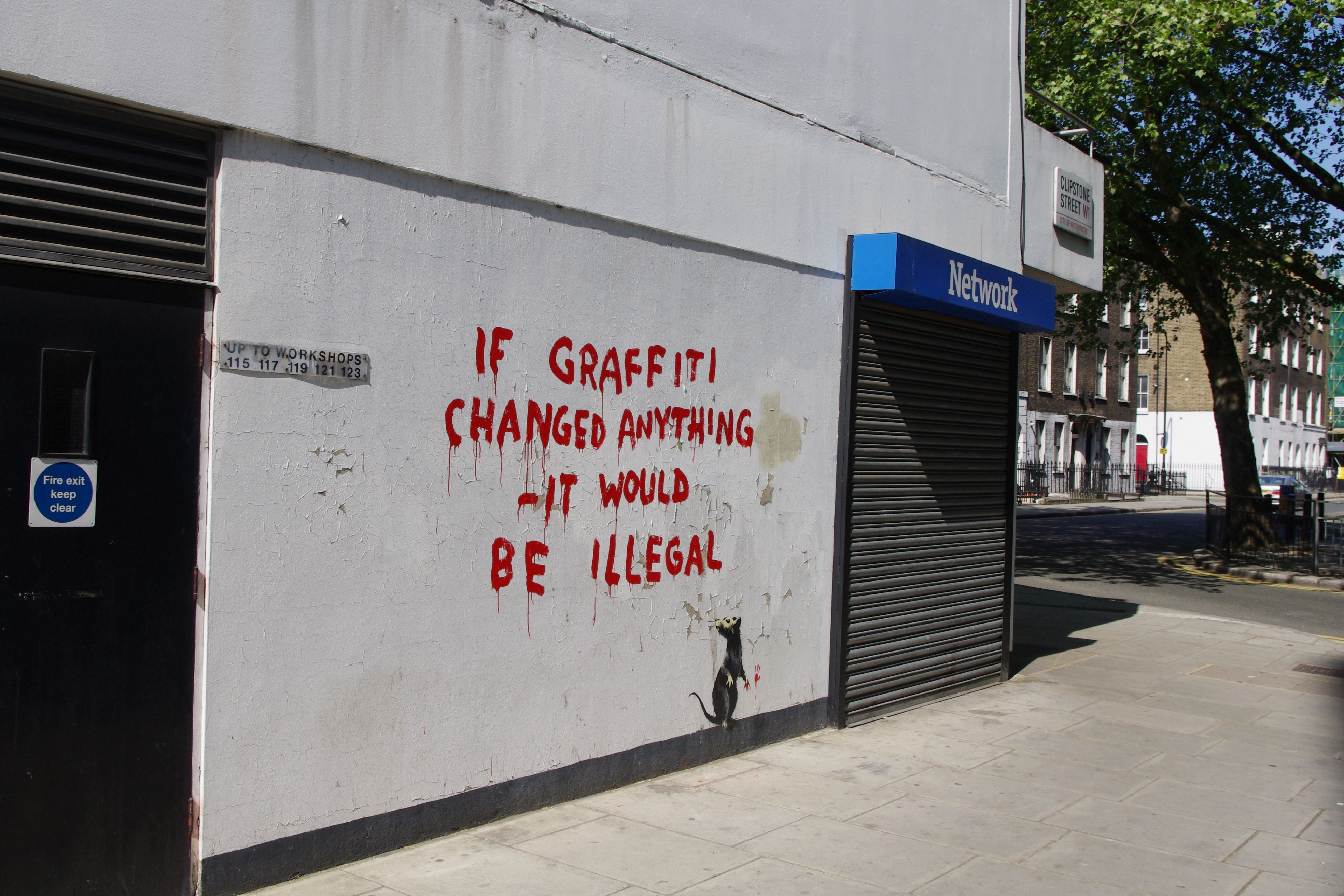 Graffiti on the wall showing the location of nearby streets