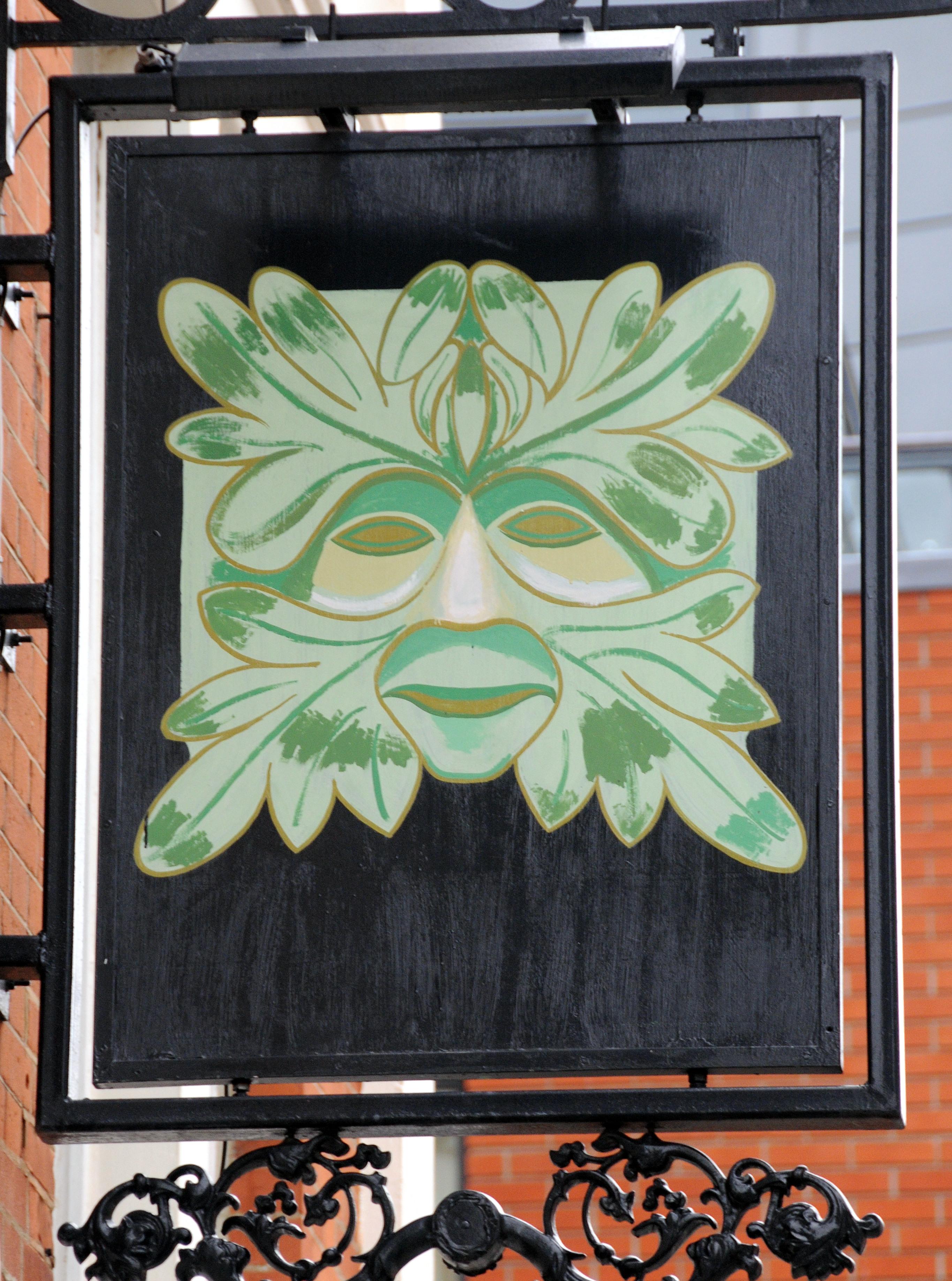 Pub sign depicting pagan Green Man.