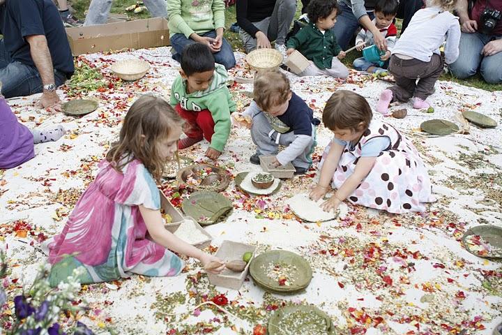 Children on a carpet making mandalas.
