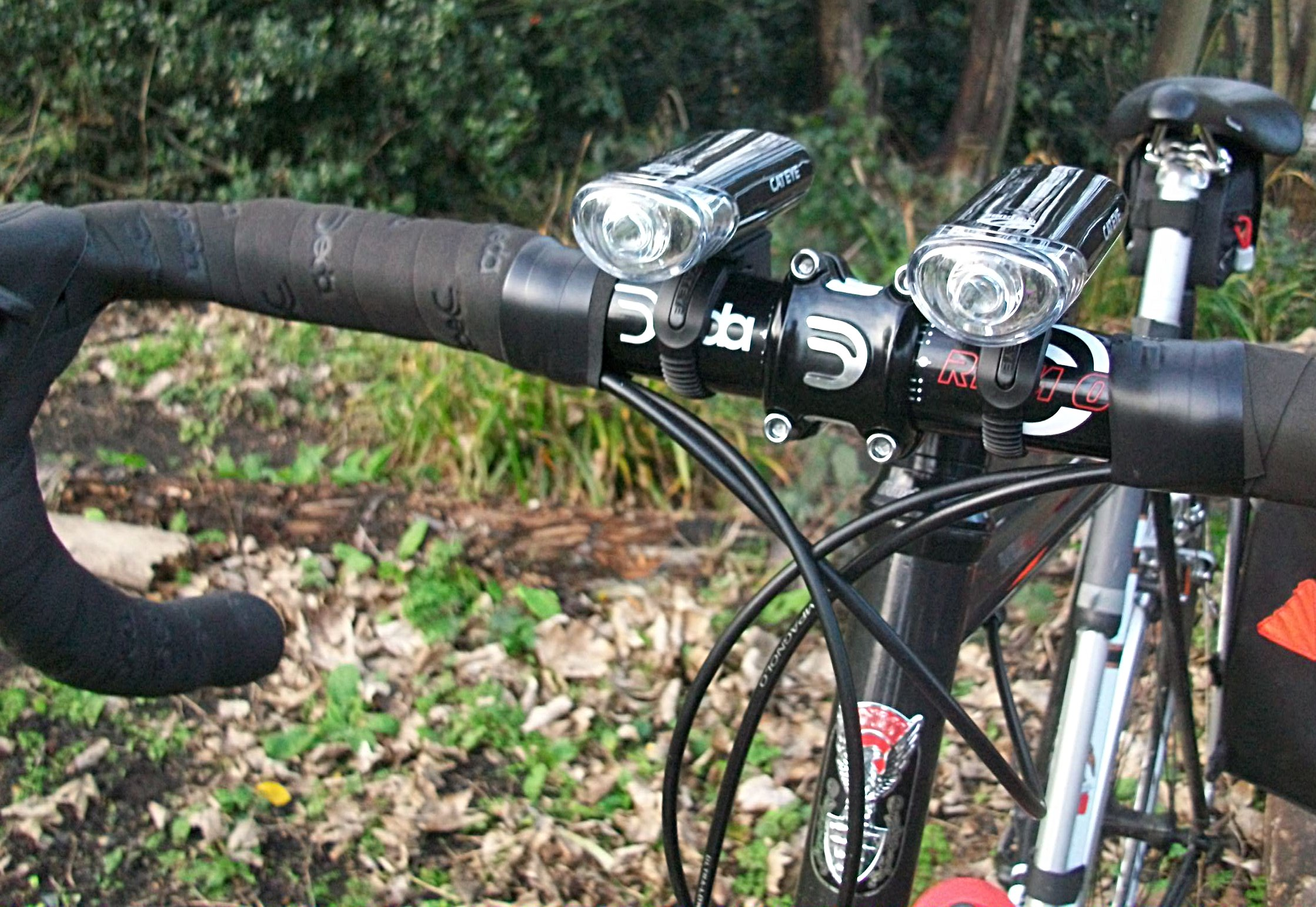 A pair of handlebars with lights attached.
