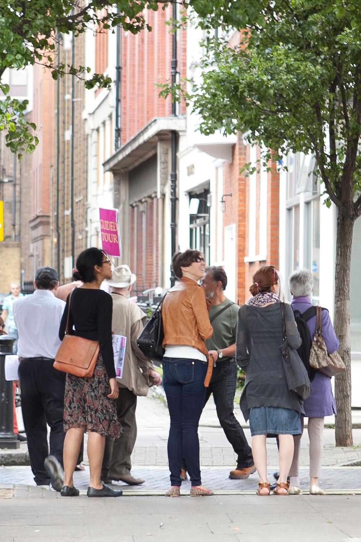 People walking along street.