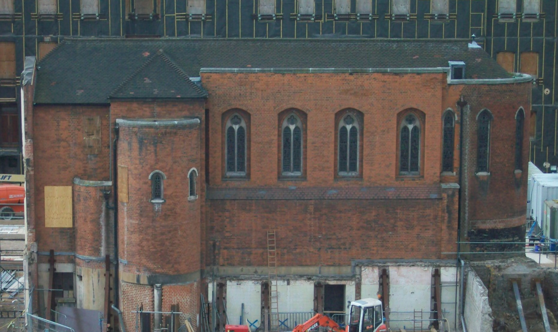 Red brick chapel building.