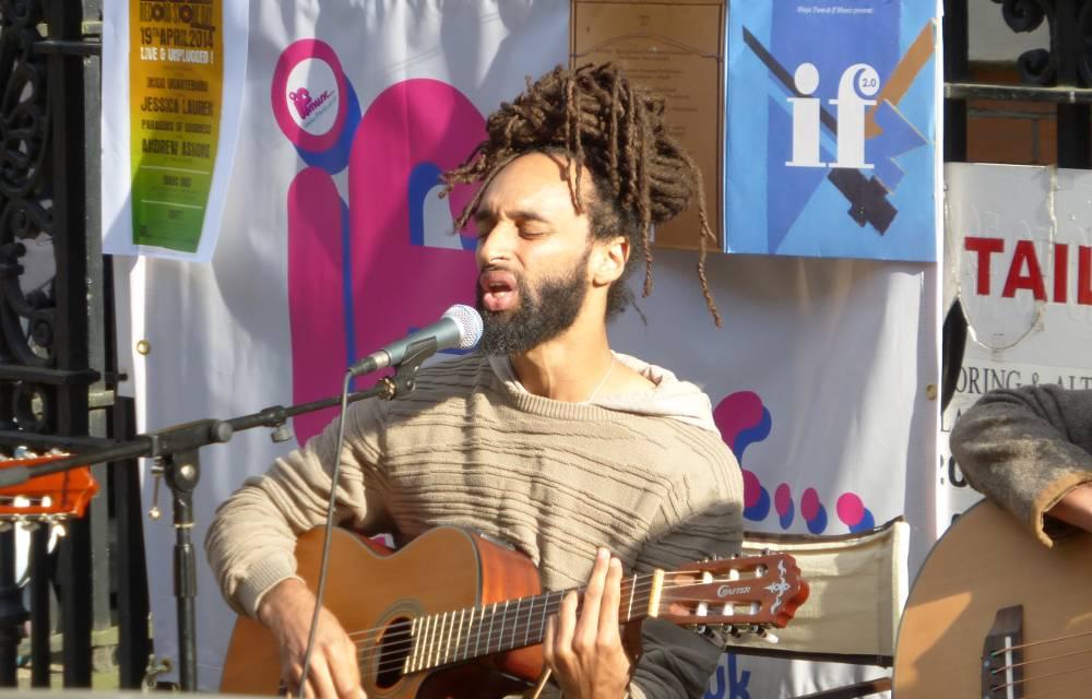 Man singing and playing guitar.