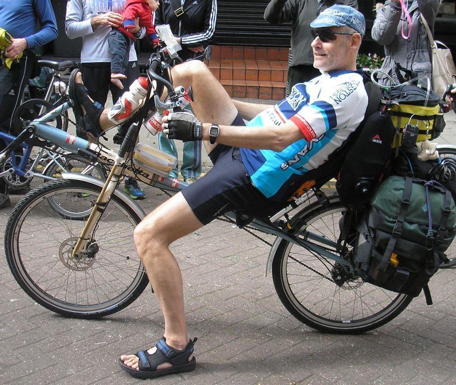 Man on recumbent cycle.