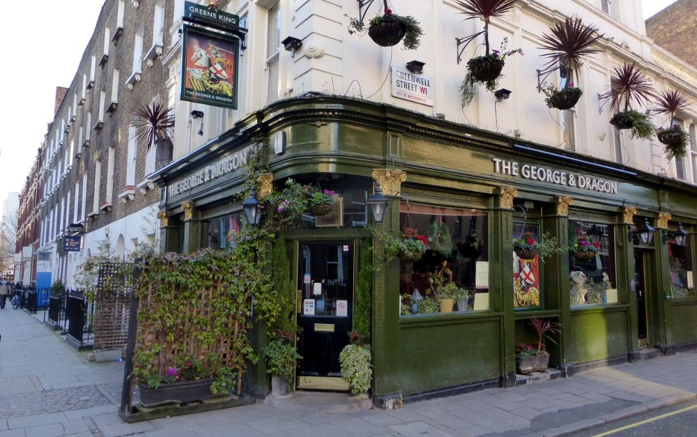 Front of pub on street corner.