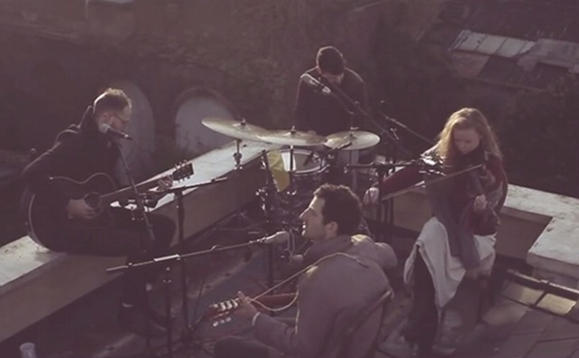 Band playing on rooftop.