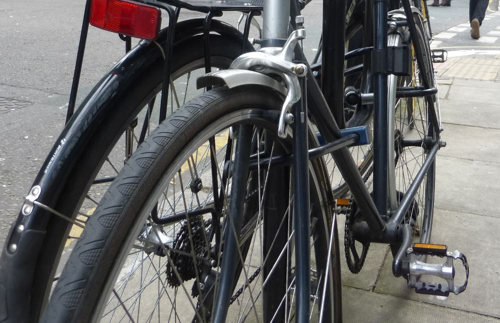 Two bicycles locked.