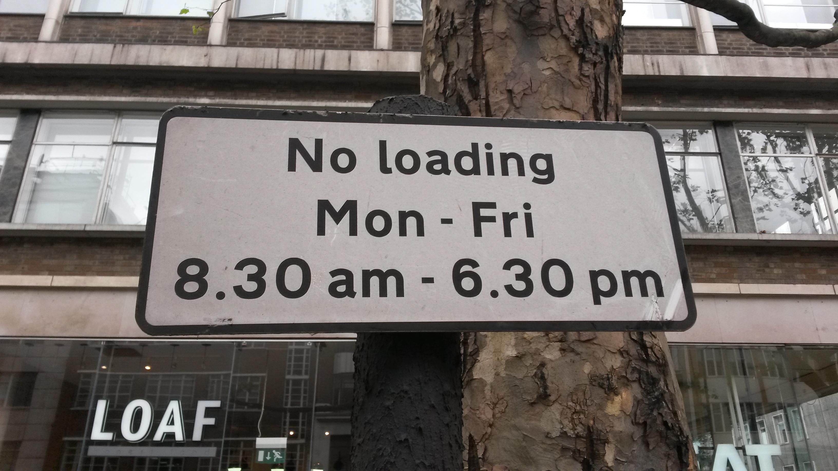 """No loading Mon - Fri 8.30am - 6.30pm"" says the sign."