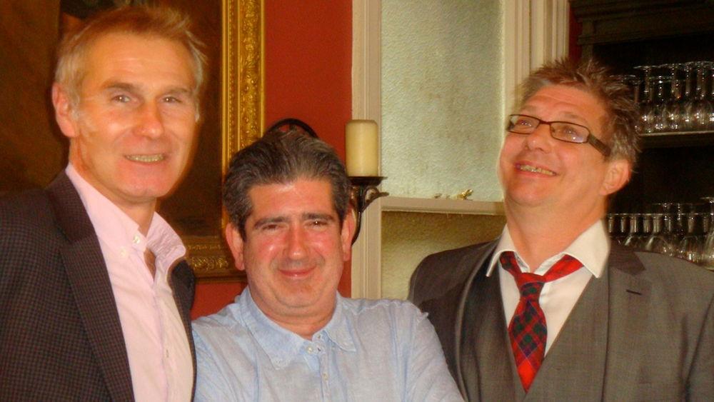 Three men standing.