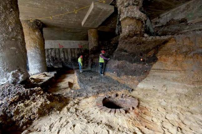 Two men in underground structure.