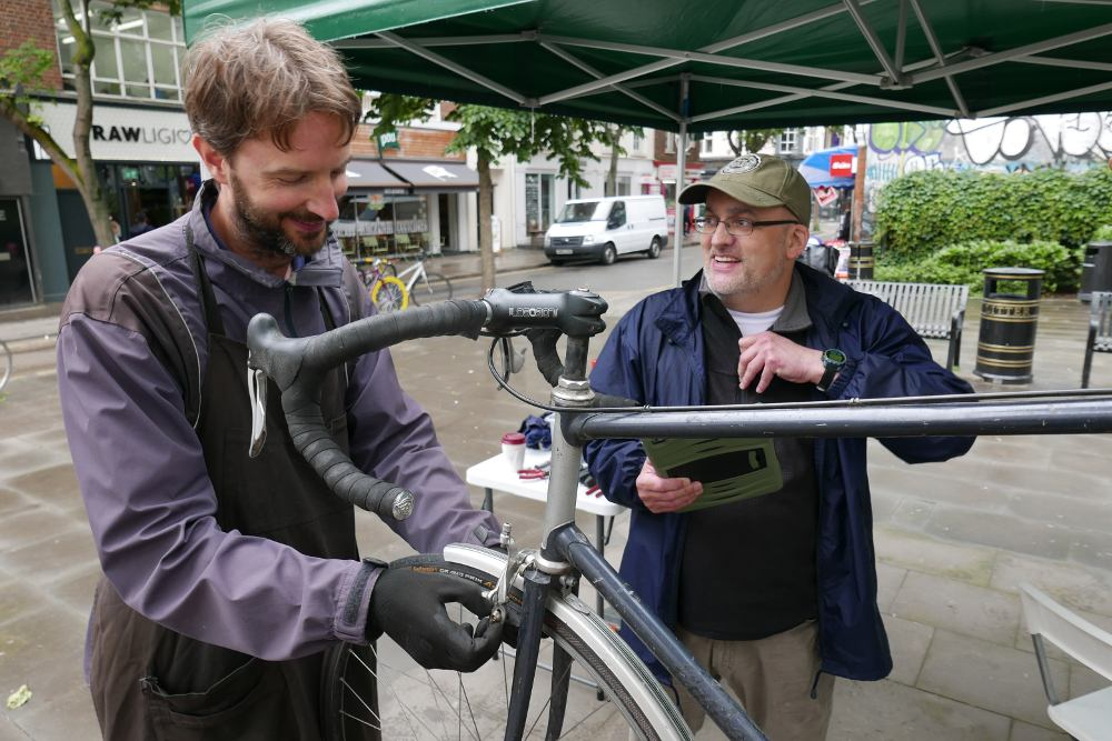 Two men and bicycle.