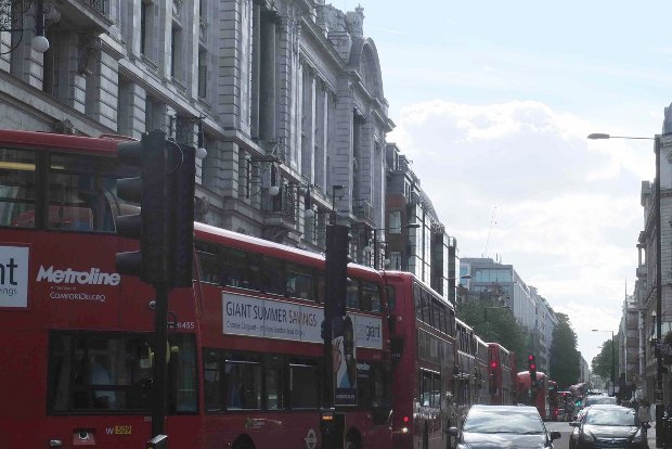 Buses queuing along street.