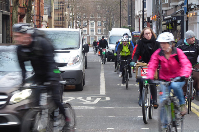 Cyclists and motor vehicles at junction.