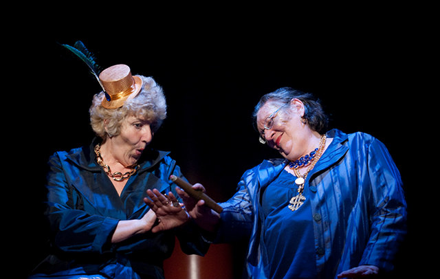 Two women performing on stage.