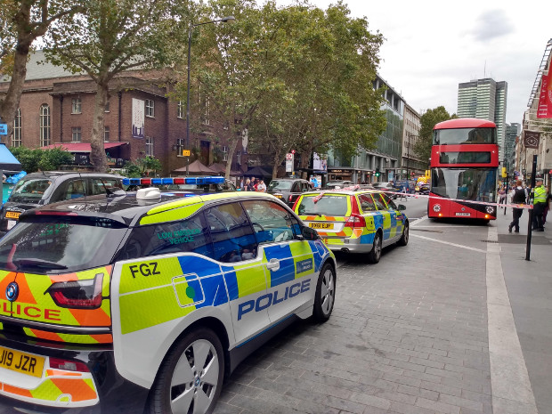 Police vehicles and bus.