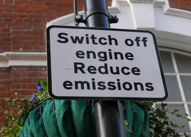 """Sign saying: """"Switch off engine. Reduce emissions."""