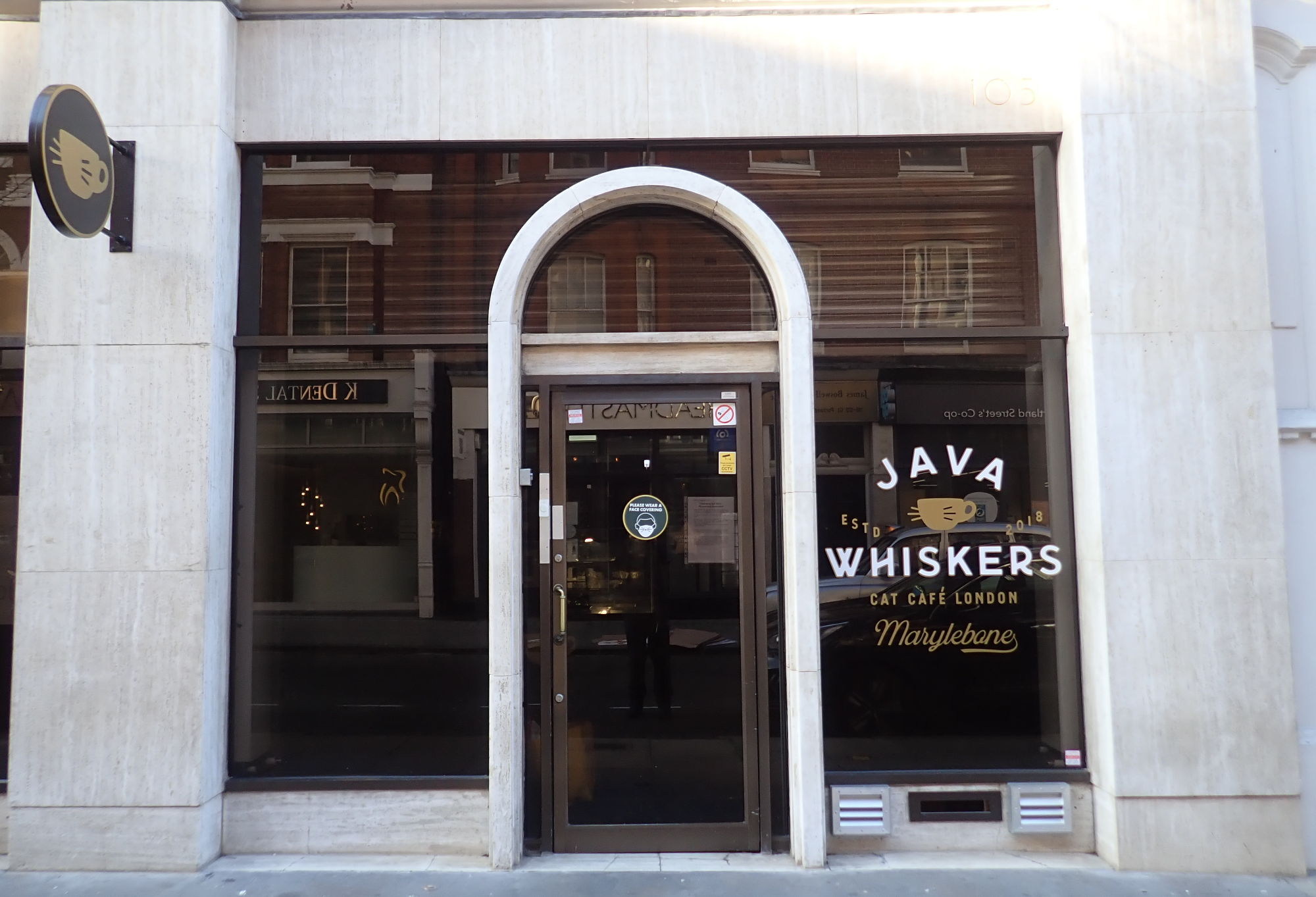 View from the street of Java Whiskers cat cafe at 105 Great Portland Street.