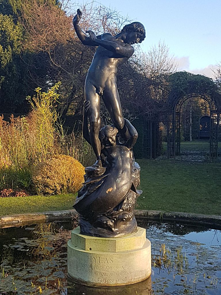 Hylas, by Henry Alfred Pegram, on top of a mermaid in a pond at St John's Lodge Gardens, Regent's Park.