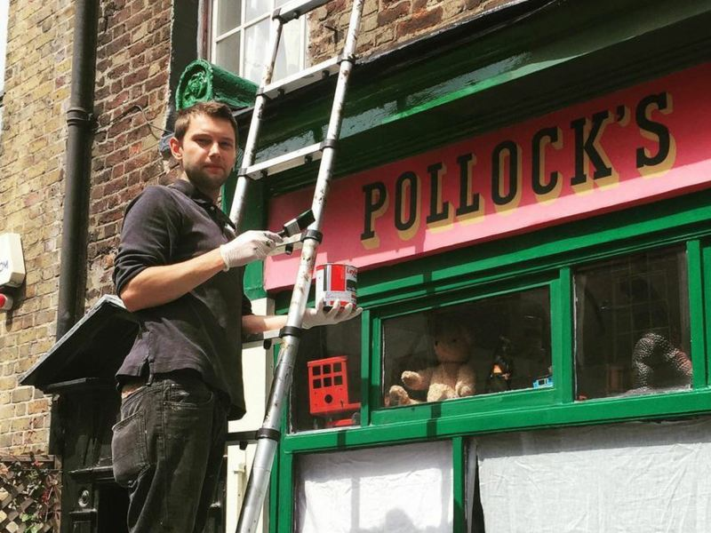 Jack Fawdry painting outside of Pollock's Toy Museum.