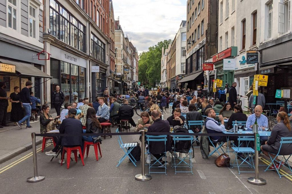 Outdoor eating and drinking in a Soho street.