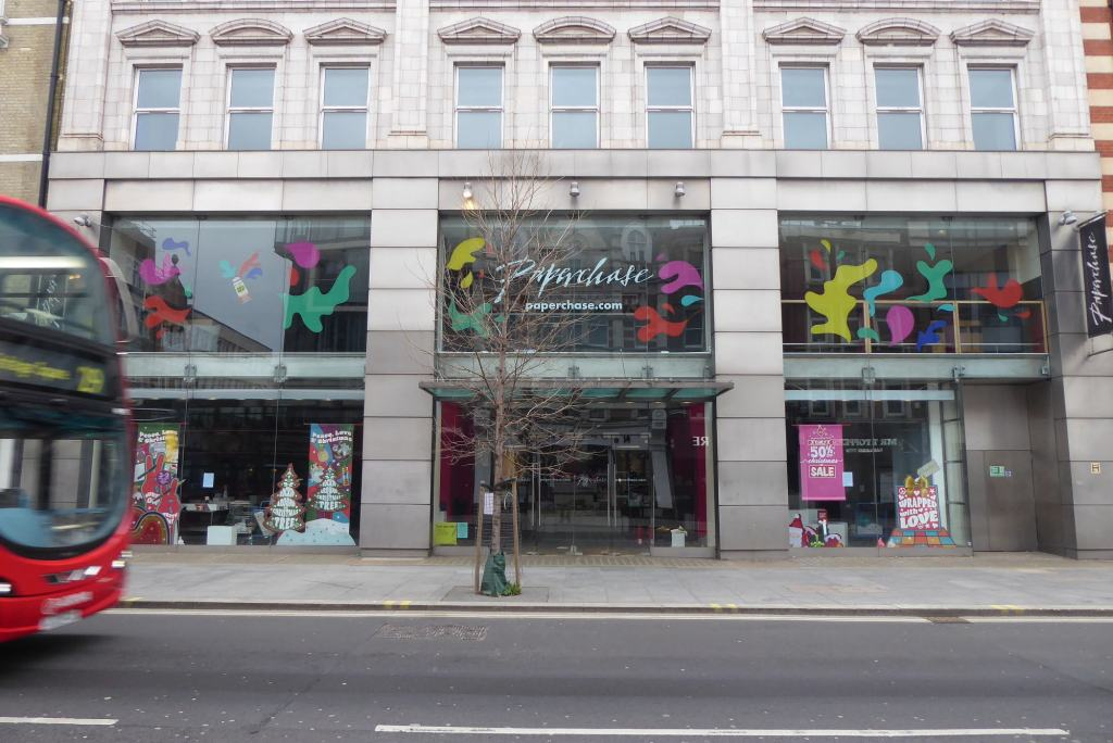 Photograph showing the front of the former Papechase store at 213-215 Tottenham Court Road.