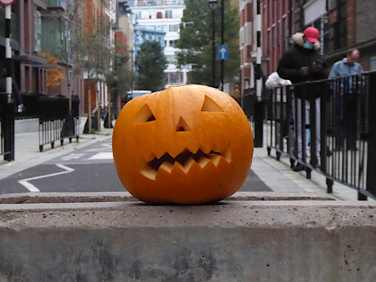 Halloween pumpkin on top of a concrete block in Riding House Street, Fitzrovia.